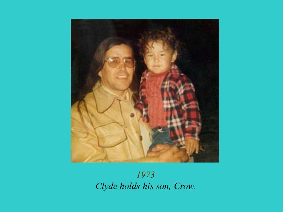 1973 Clyde holds his son, Crow.