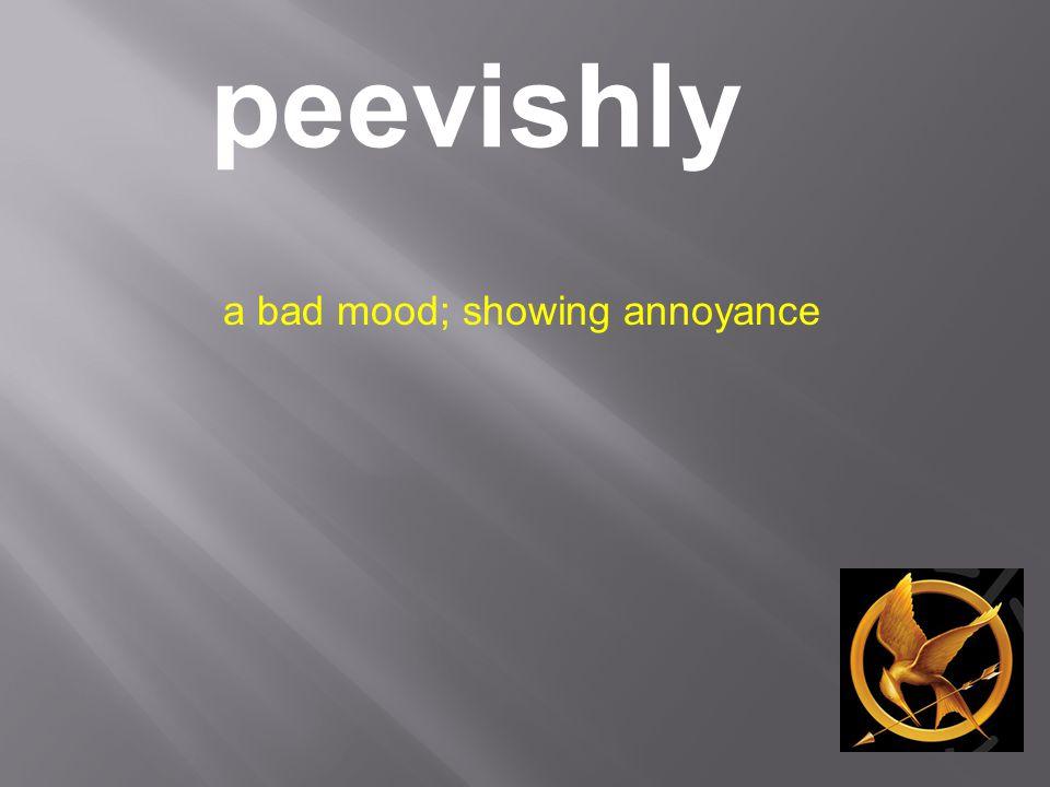 peevishly a bad mood; showing annoyance