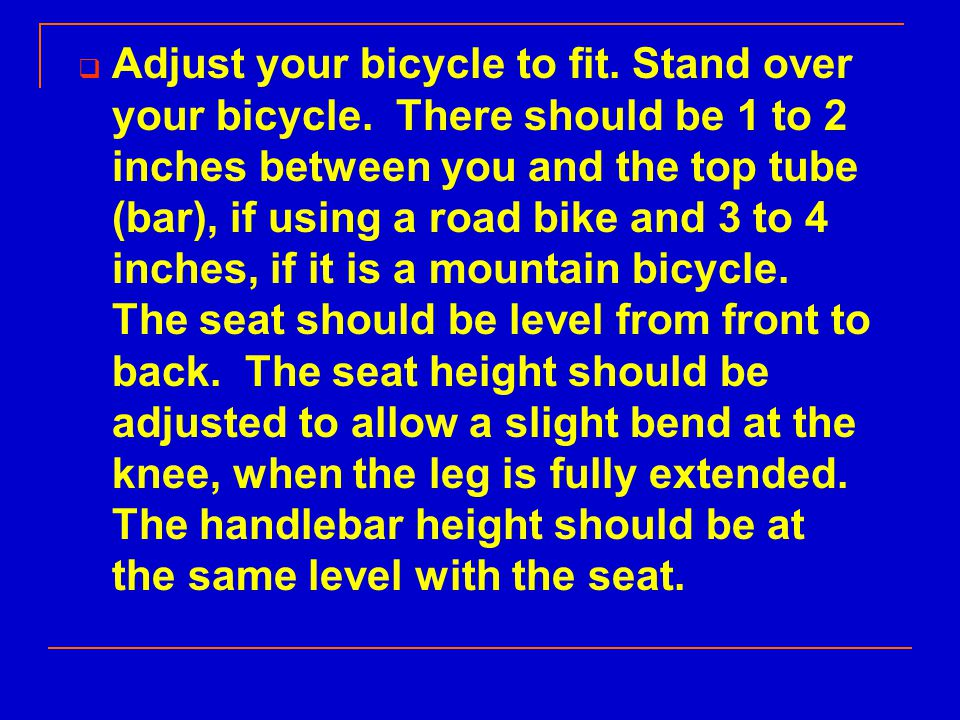  Adjust your bicycle to fit. Stand over your bicycle.