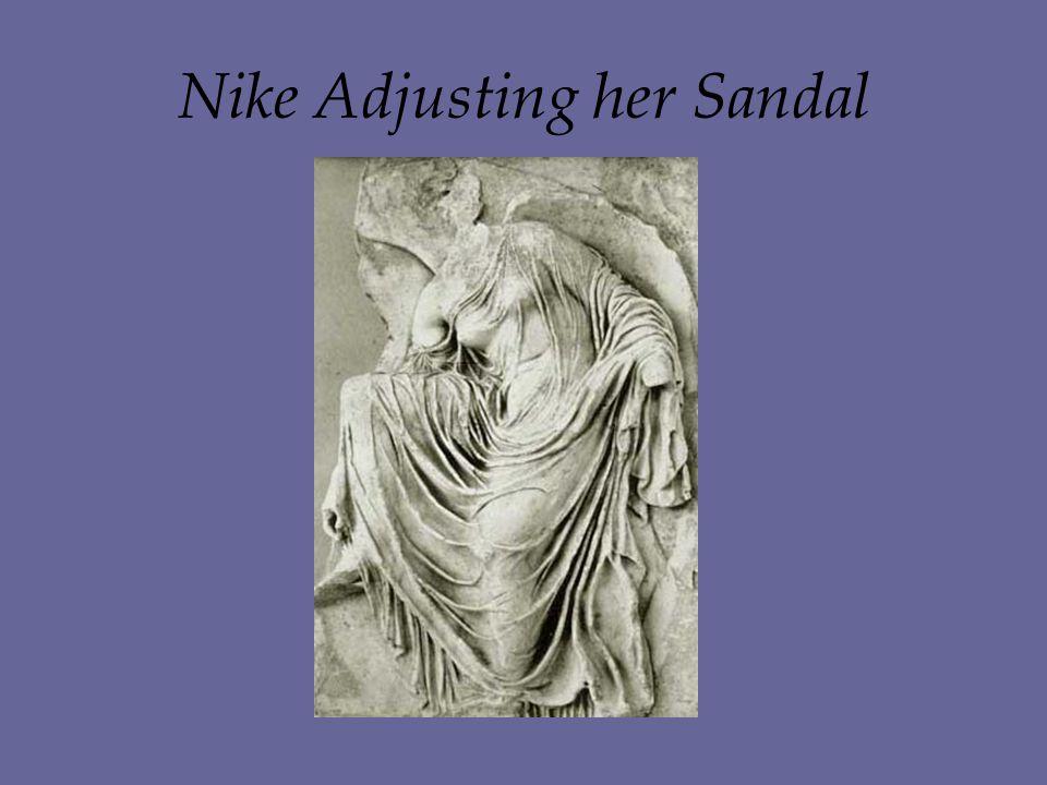 Nike Adjusting her Sandal