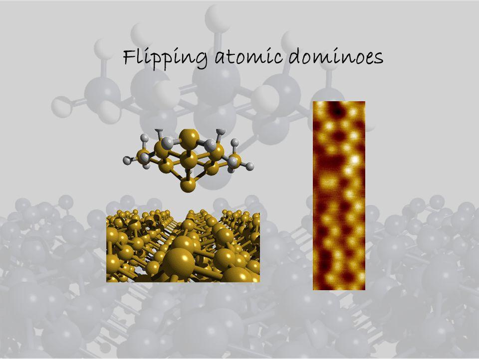 Flipping atomic dominoes