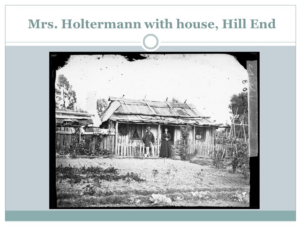 Mrs. Holtermann with house, Hill End