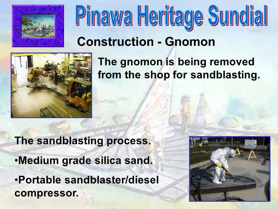 Construction - Gnomon The gnomon is being removed from the shop for sandblasting. The sandblasting process. Medium grade silica sand. Portable sandbla