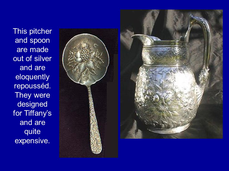 This pitcher and spoon are made out of silver and are eloquently repousséd.