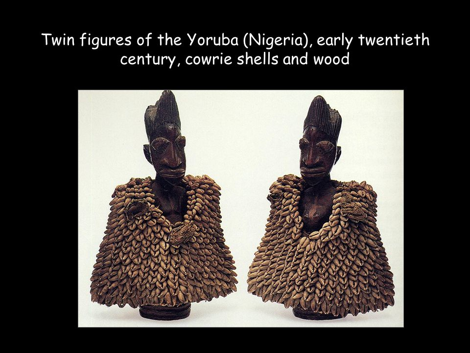 Twin figures of the Yoruba (Nigeria), early twentieth century, cowrie shells and wood