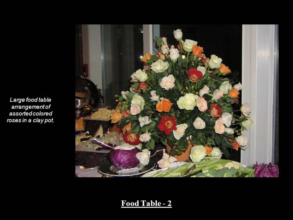 Large food table arrangement of assorted colored roses in a clay pot. Food Table - 2