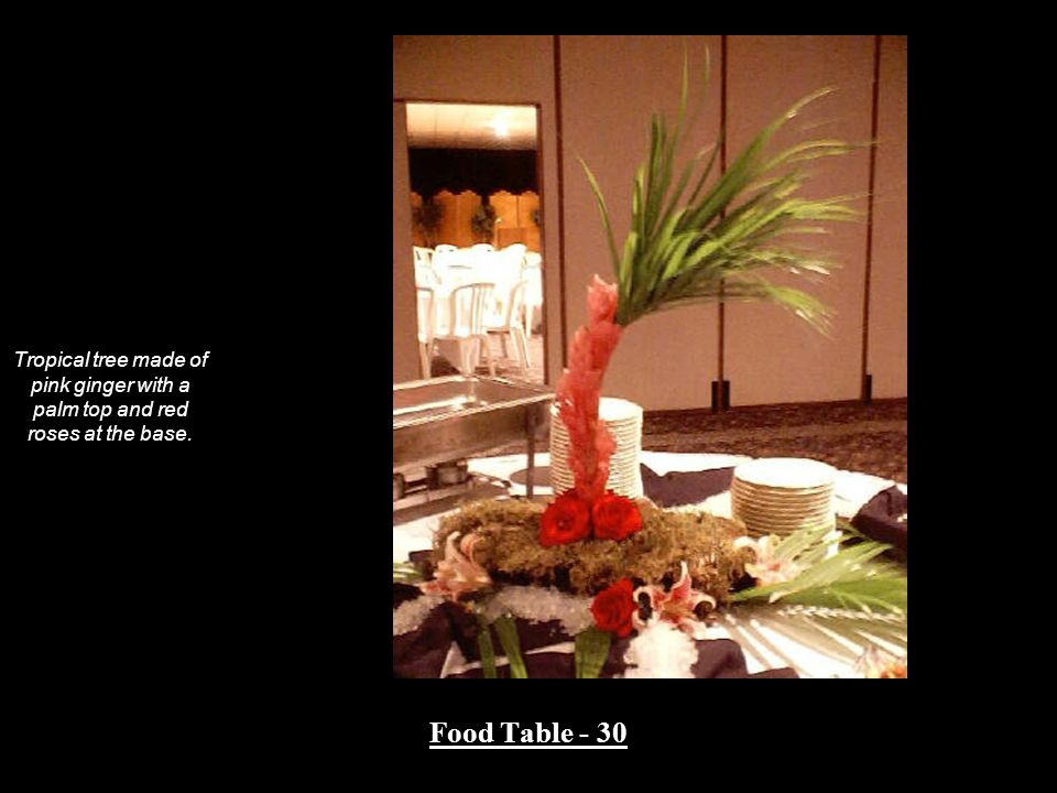 Tropical tree made of pink ginger with a palm top and red roses at the base. Food Table - 30