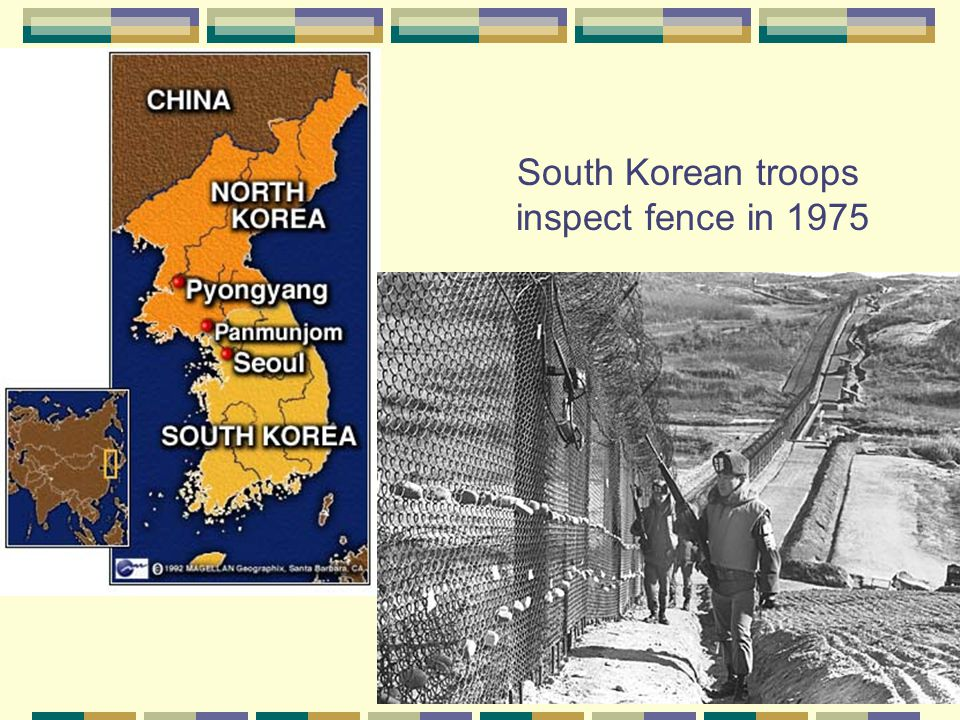 South Korean troops inspect fence in 1975