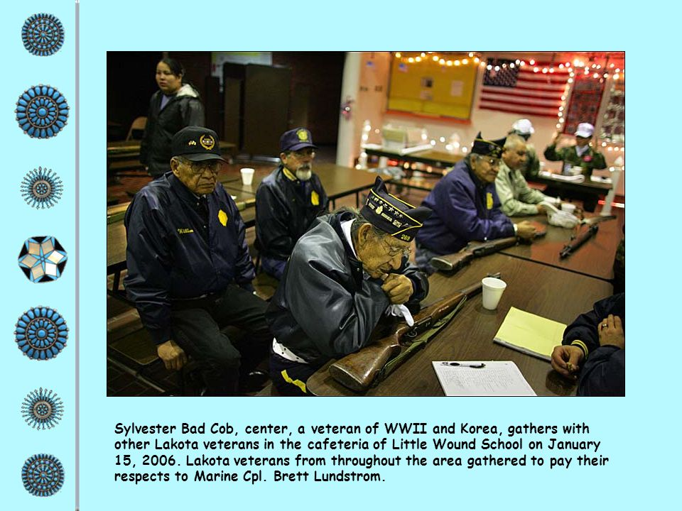 Sylvester Bad Cob, center, a veteran of WWII and Korea, gathers with other Lakota veterans in the cafeteria of Little Wound School on January 15, 2006.