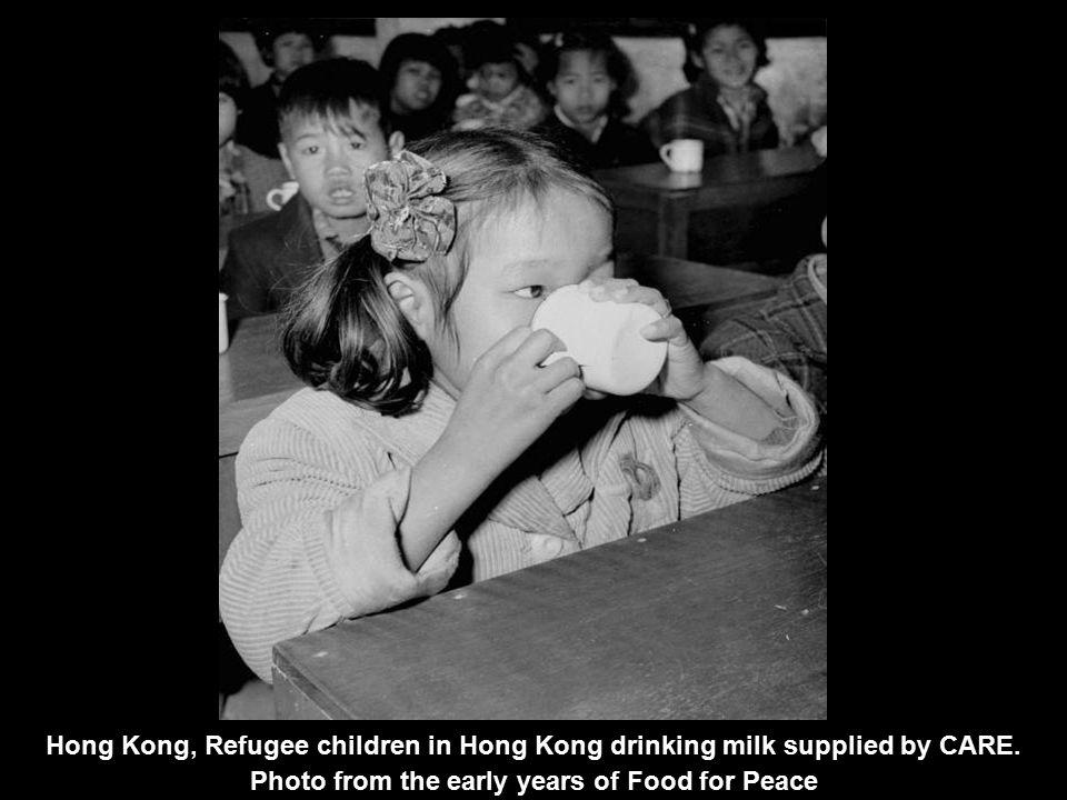 Hong Kong, Refugee children in Hong Kong drinking milk supplied by CARE.