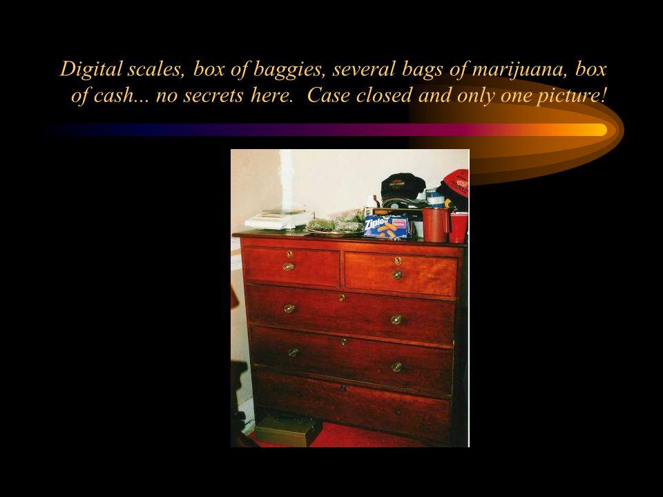 Digital scales, box of baggies, several bags of marijuana, box of cash...