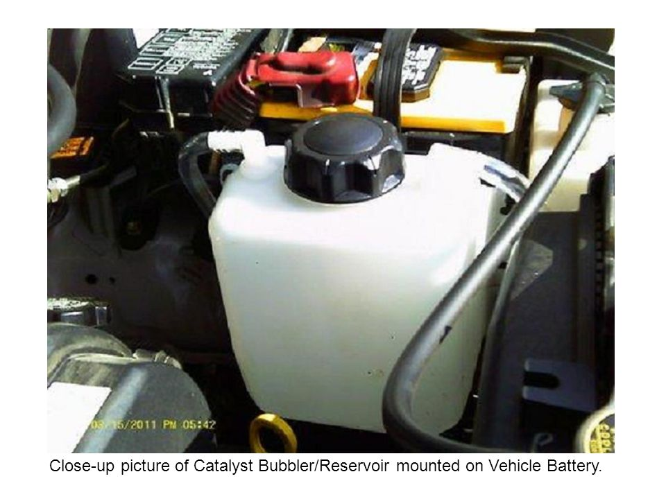 Close-up picture of Catalyst Bubbler/Reservoir mounted on Vehicle Battery.