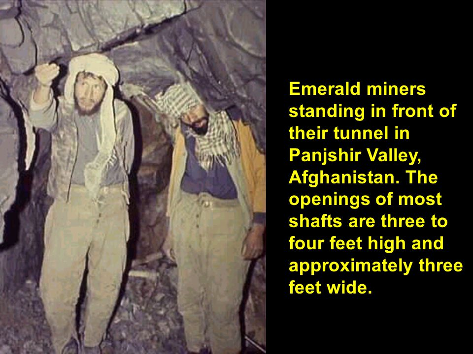 Emerald miners standing in front of their tunnel in Panjshir Valley, Afghanistan. The openings of most shafts are three to four feet high and approxim