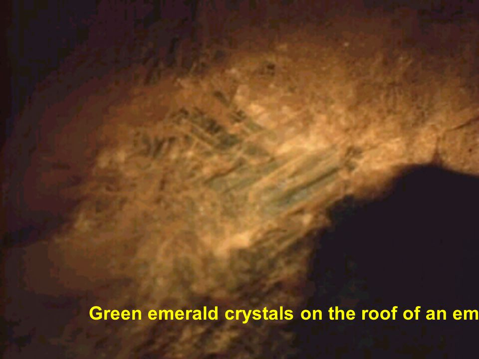 Green emerald crystals on the roof of an emerald tunnel.
