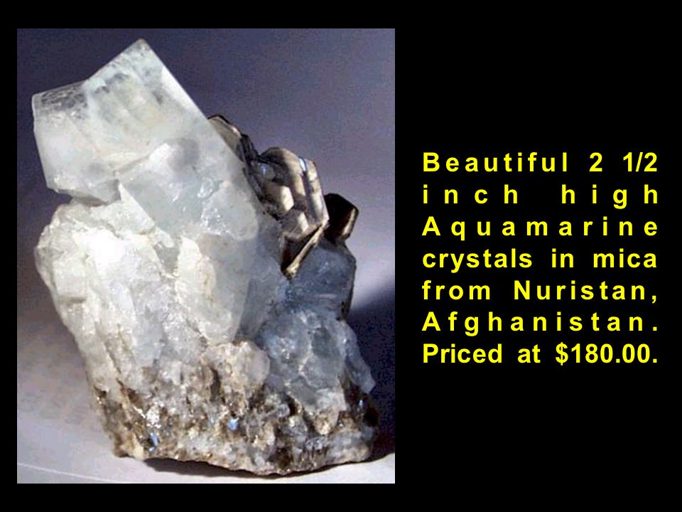 Beautiful 2 1/2 inch high Aquamarine crystals in mica from Nuristan, Afghanistan. Priced at $180.00.