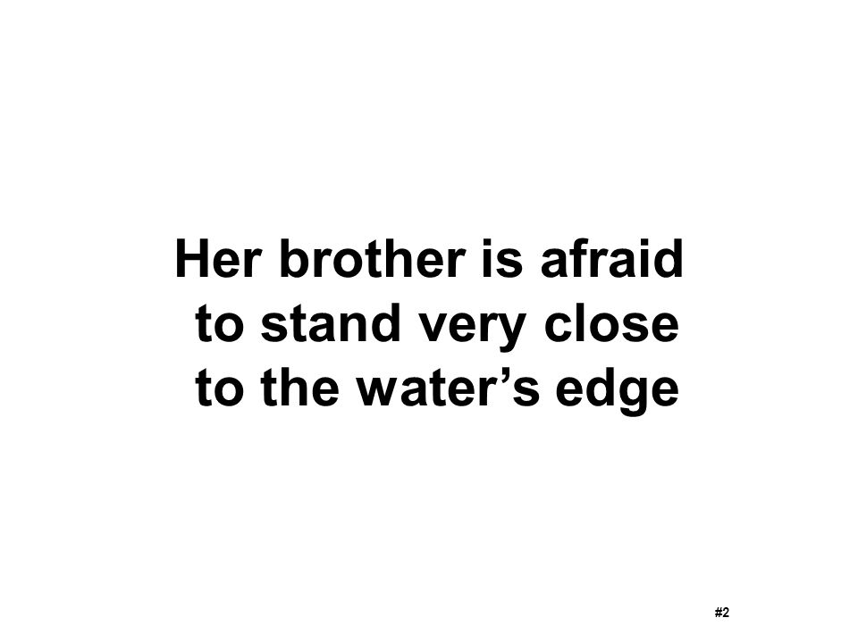 Her brother is afraid to stand very close to the water's edge #2