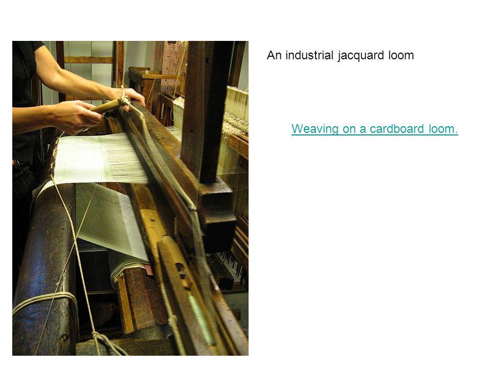 An industrial jacquard loom Weaving on a cardboard loom.