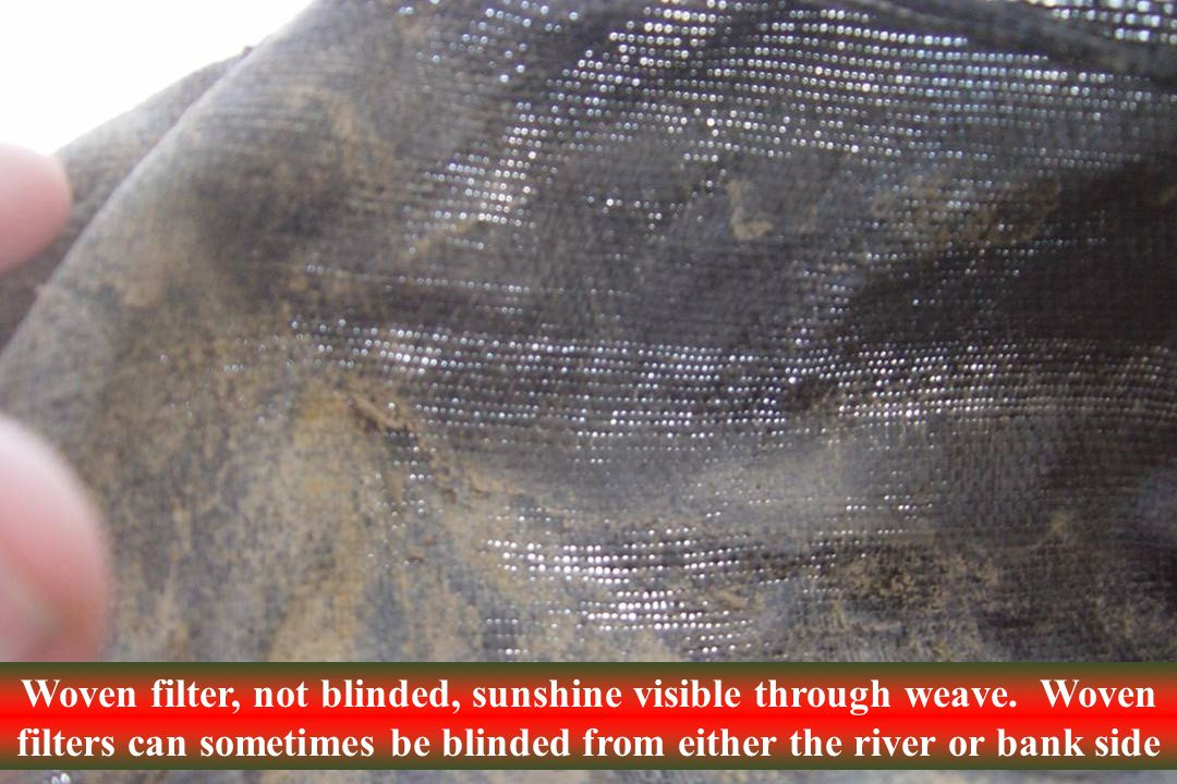 Woven filter, not blinded, sunshine visible through weave.
