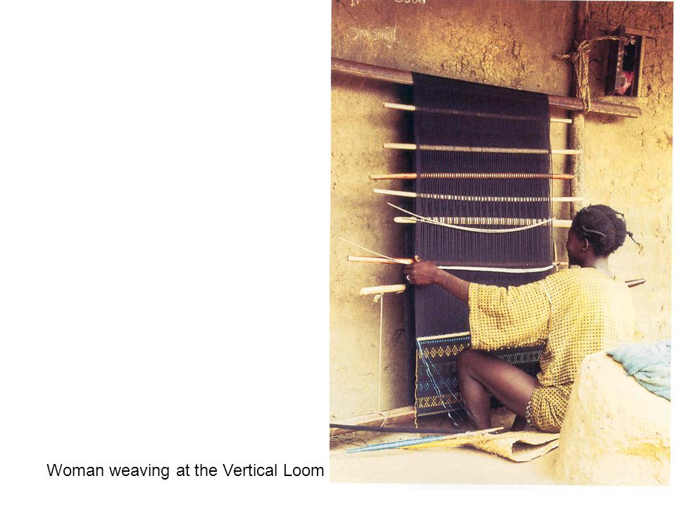 Woman weaving at the Vertical Loom