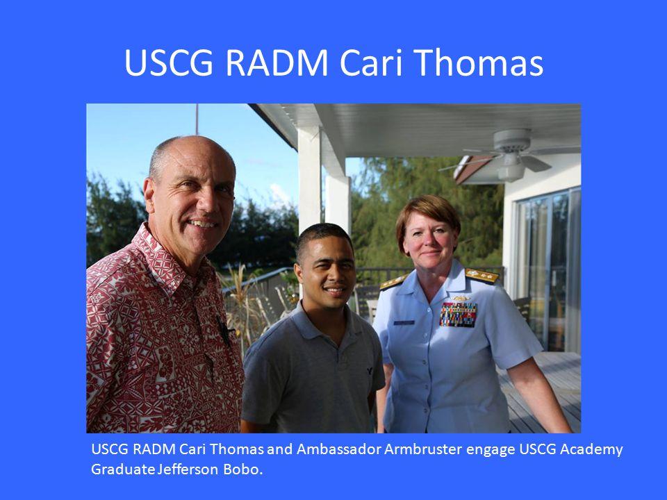 USCG RADM Cari Thomas USCG RADM Cari Thomas and Ambassador Armbruster engage USCG Academy Graduate Jefferson Bobo.