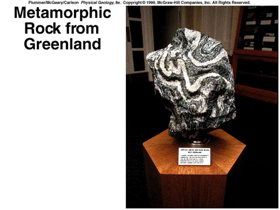 Types of Metamorphism zRegional Metamorphism zTakes place at considerable depth and high temperatures yBasalt => greenschist- actinolite, and sodium-rich plagioclase yBasalt => amphibole schist - hornblende, plagioclase feldspar, and garnet