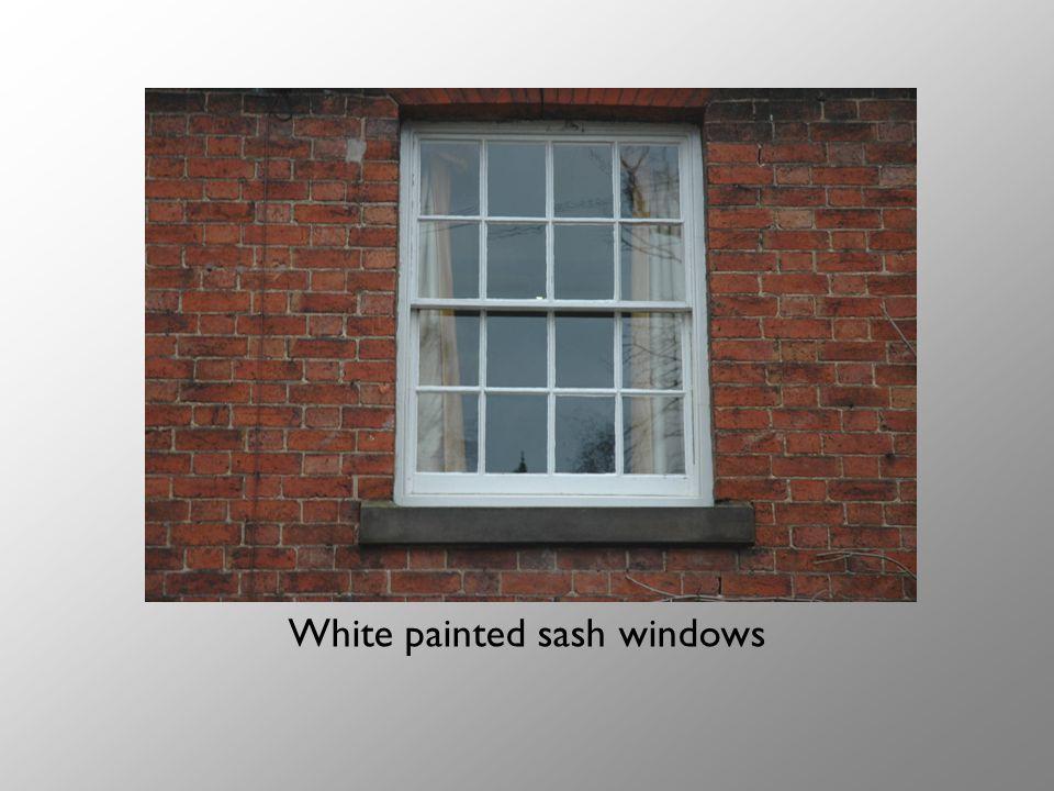 White painted sash windows