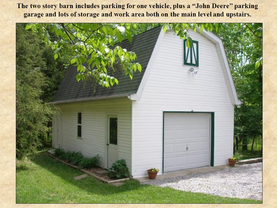"The two story barn includes parking for one vehicle, plus a ""John Deere"" parking garage and lots of storage and work area both on the main level and u"