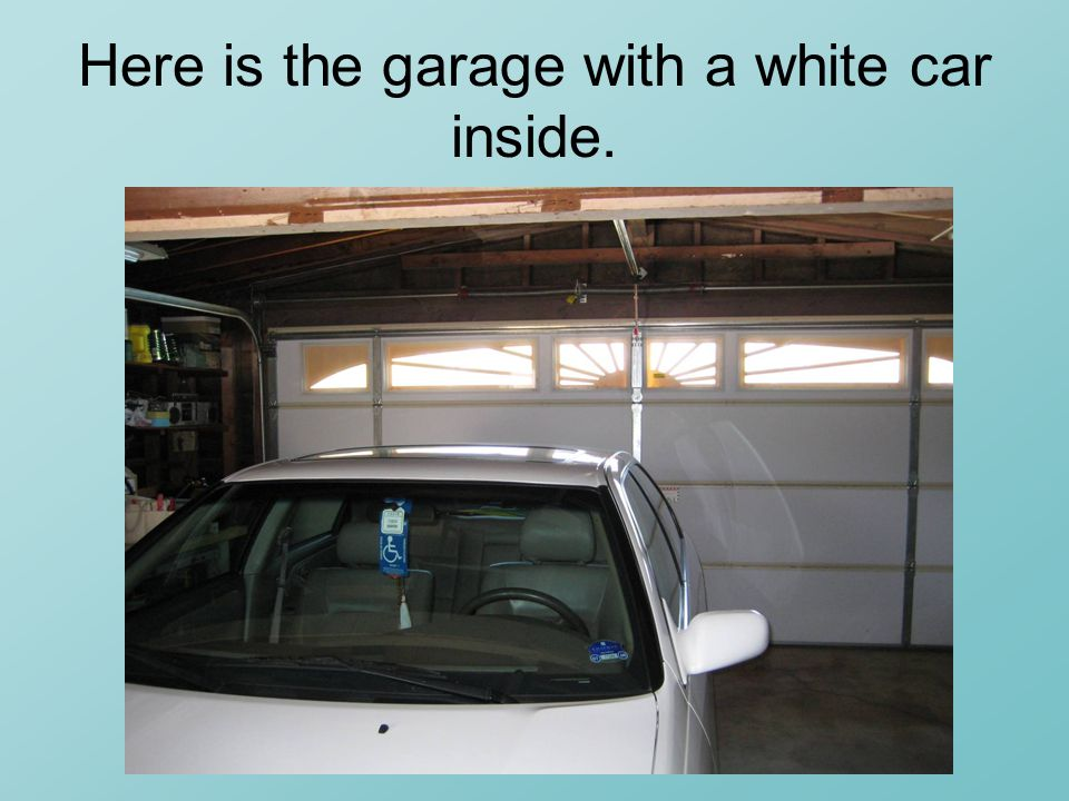 Here is the garage with a white car inside.