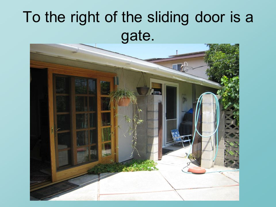 To the right of the sliding door is a gate.