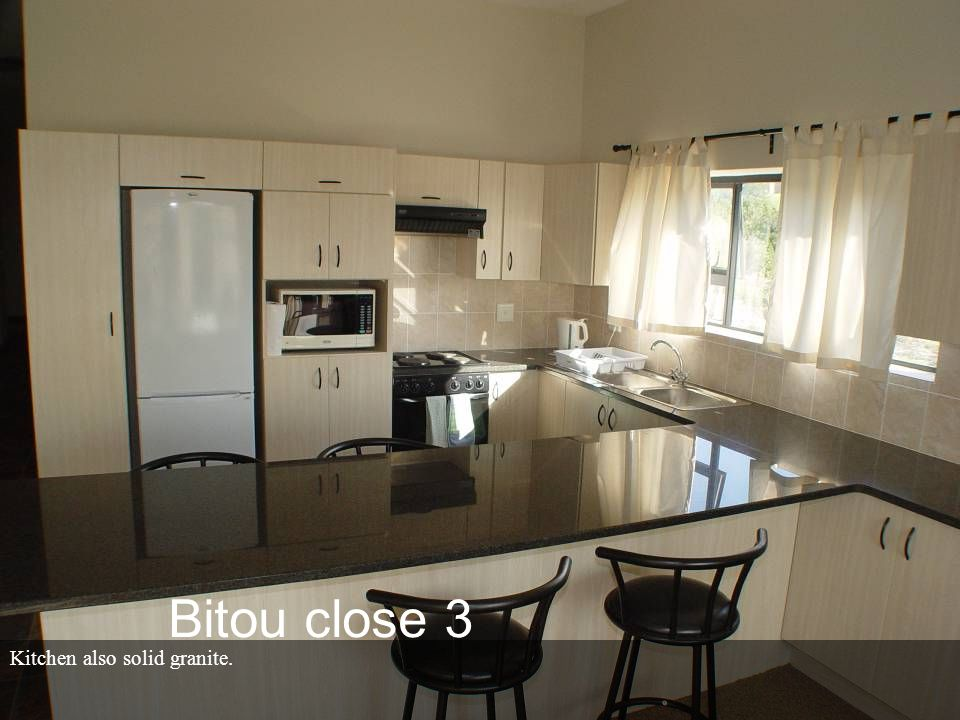 Kitchen also solid granite. Bitou close 3