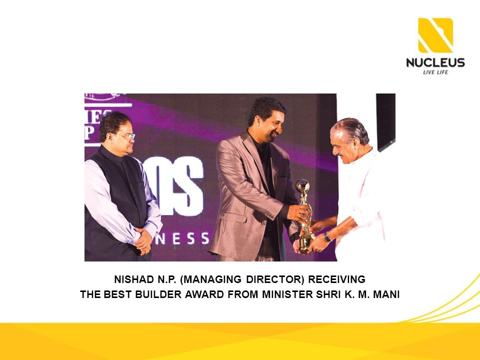 NISHAD N.P. (MANAGING DIRECTOR) RECEIVING THE BEST BUILDER AWARD FROM MINISTER SHRI K. M. MANI