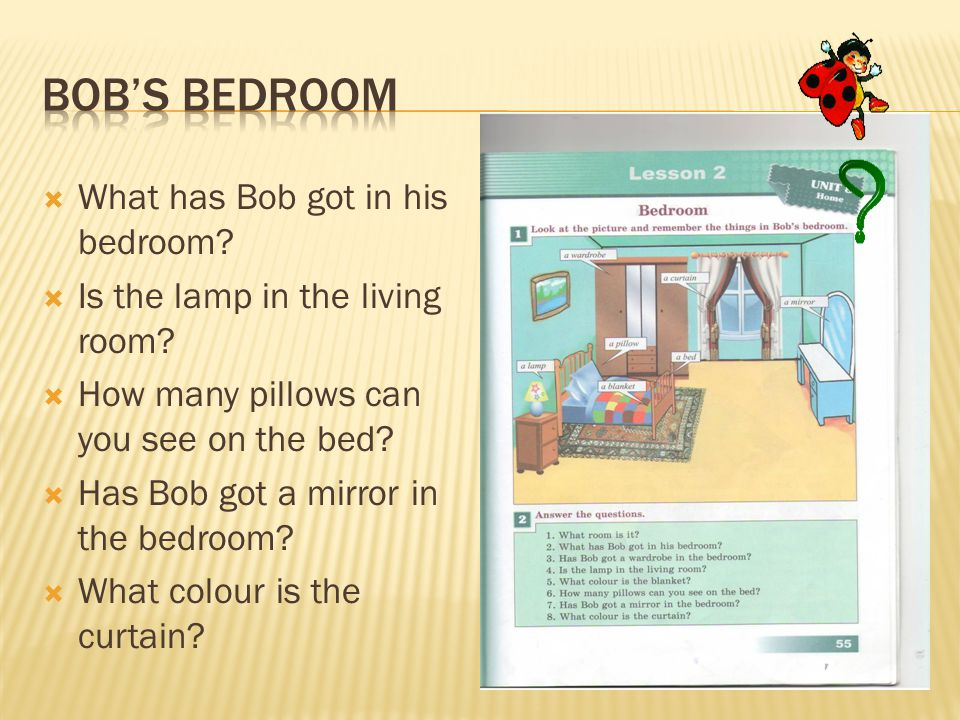  What has Bob got in his bedroom?  Is the lamp in the living room?  How many pillows can you see on the bed?  Has Bob got a mirror in the bedroom?