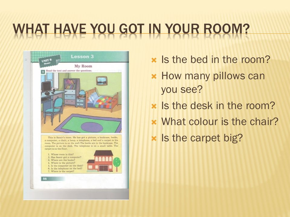  Is the bed in the room?  How many pillows can you see?  Is the desk in the room?  What colour is the chair?  Is the carpet big?