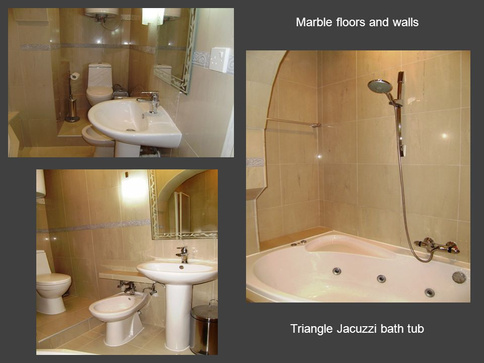 Triangle Jacuzzi bath tub Marble floors and walls