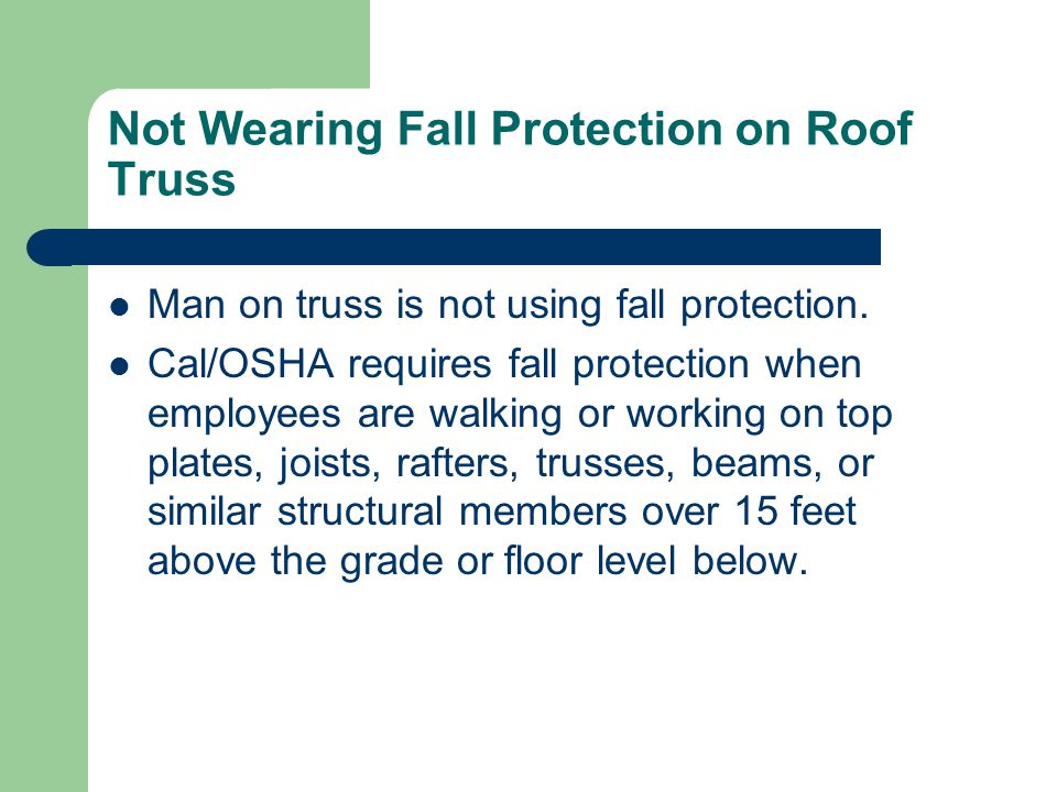 Not Wearing Fall Protection on Roof Truss Man on truss is not using fall protection.