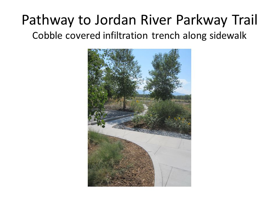 Pathway to Jordan River Parkway Trail Cobble covered infiltration trench along sidewalk