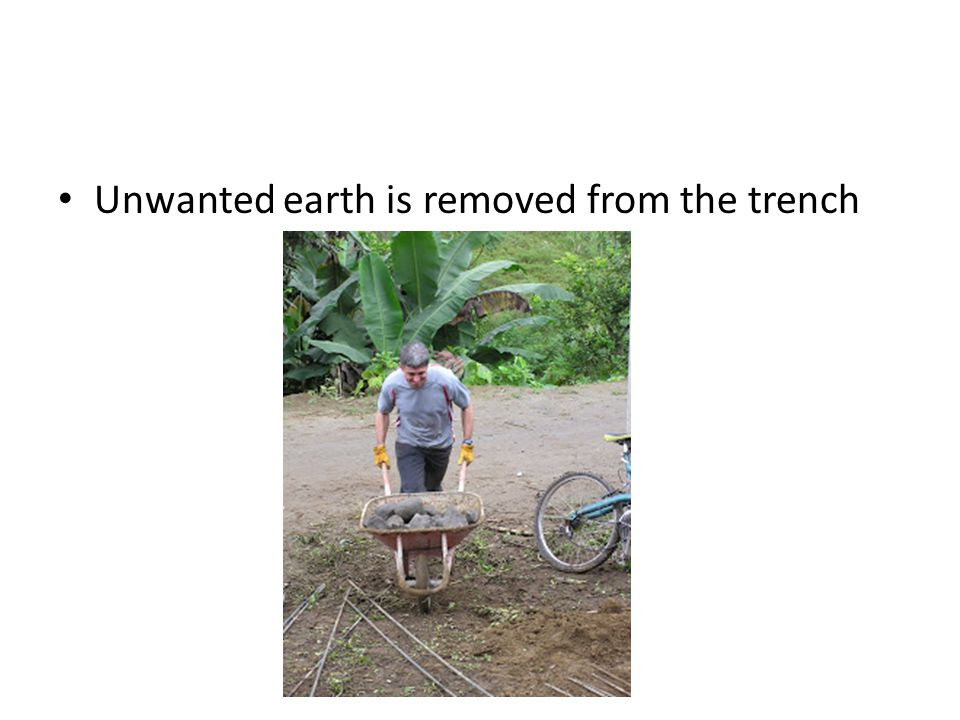 Unwanted earth is removed from the trench