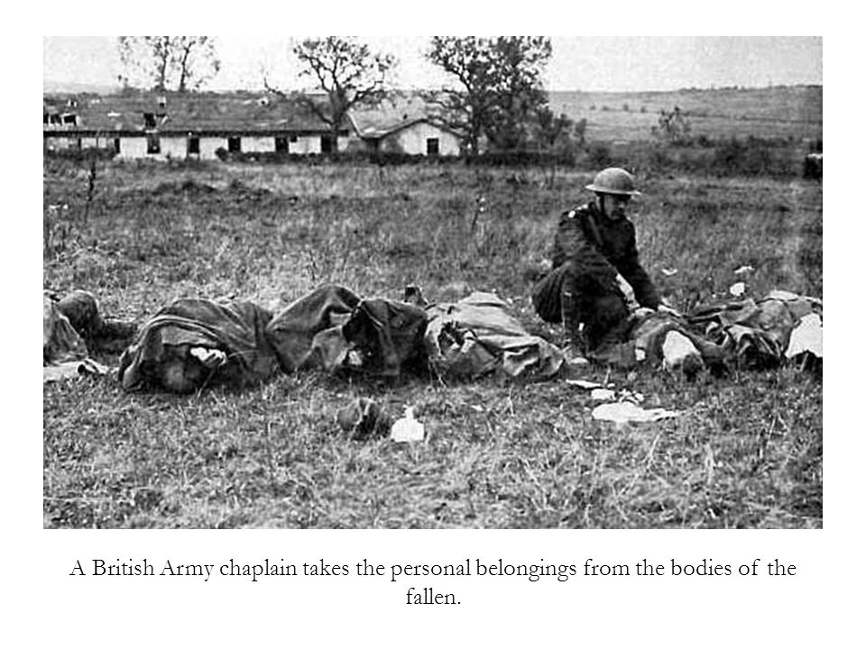 A British Army chaplain takes the personal belongings from the bodies of the fallen.