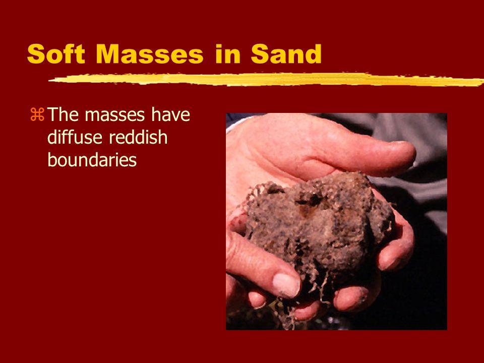 Soft Masses in Sand zThe masses have diffuse reddish boundaries