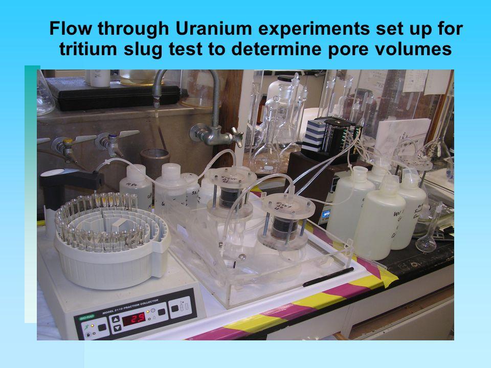 Flow through Uranium experiments set up for tritium slug test to determine pore volumes