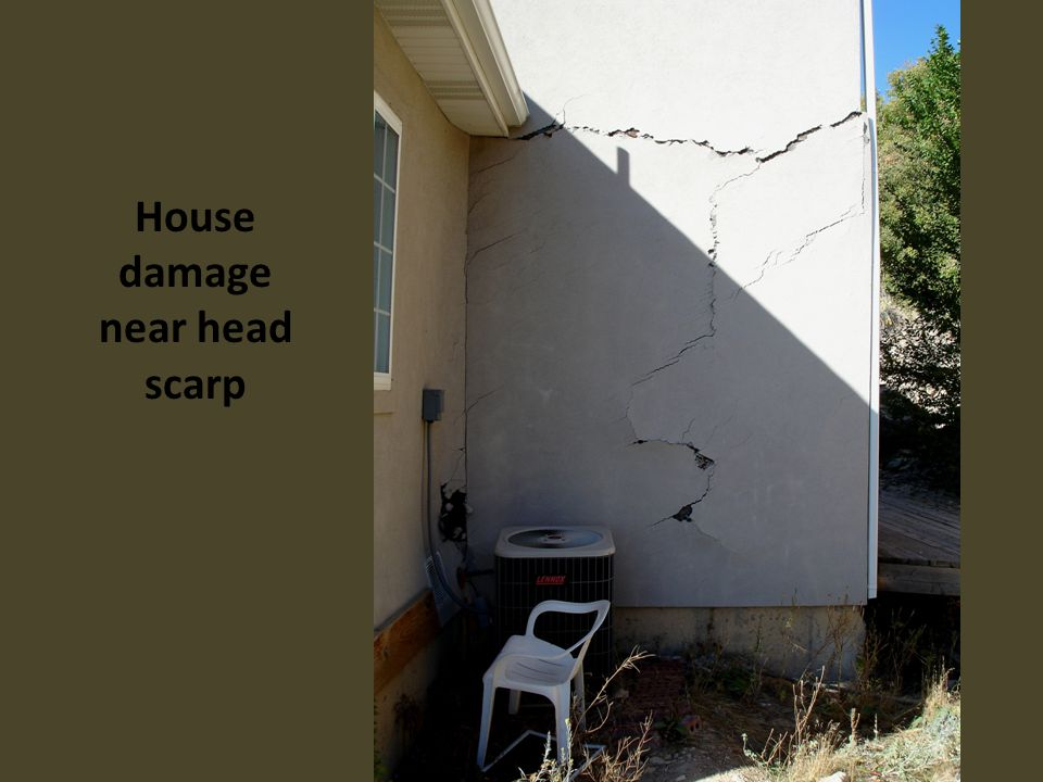 House damage near head scarp