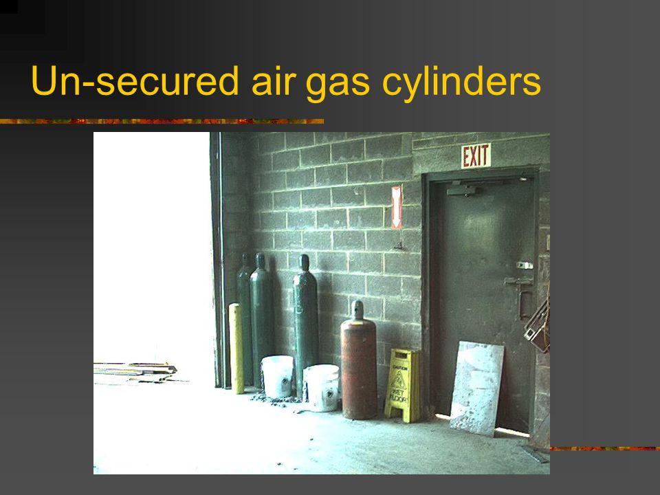 Bench grinder with improperly adjusted guard.