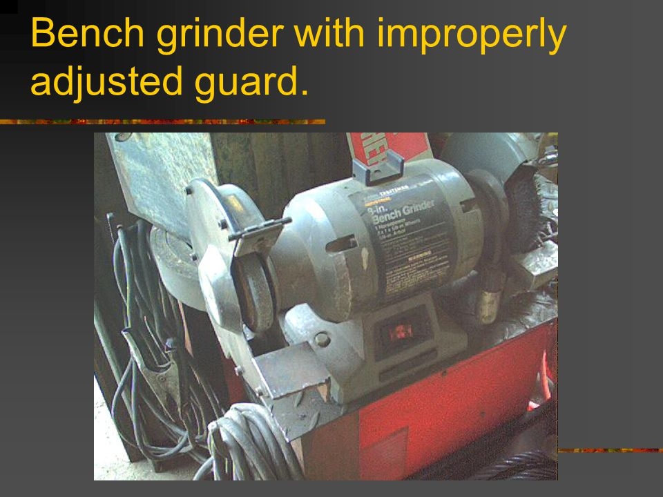 Un-secured drill press, and operator not wearing face shield