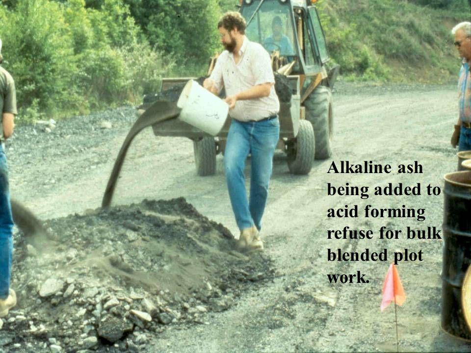 Alkaline ash being added to acid forming refuse for bulk blended plot work.