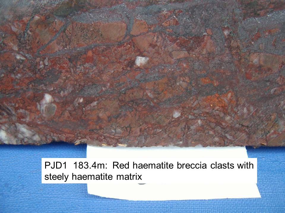 PJD1 183.4m: Red haematite breccia clasts with steely haematite matrix