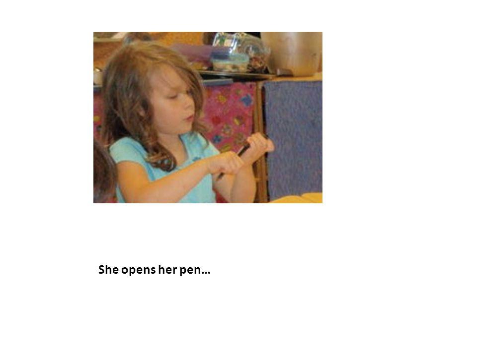 She opens her pen…