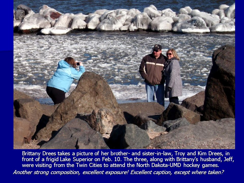 Brittany Drees takes a picture of her brother- and sister-in-law, Troy and Kim Drees, in front of a frigid Lake Superior on Feb.
