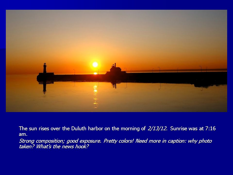 The sun rises over the Duluth harbor on the morning of 2/13/12.