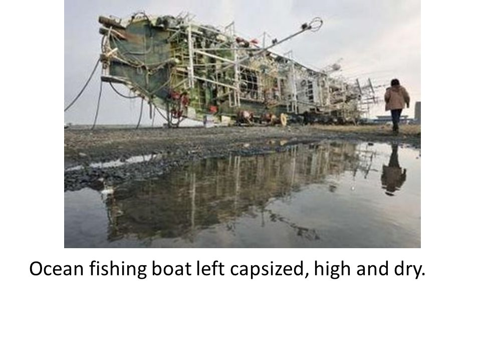 Ocean fishing boat left capsized, high and dry.
