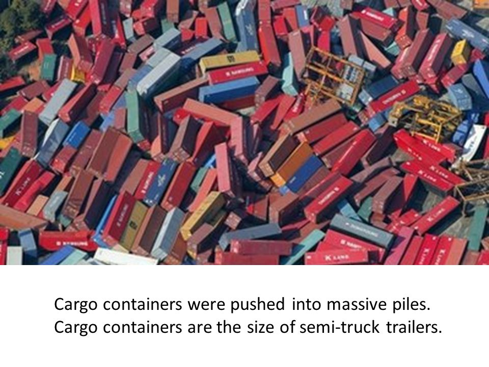 Cargo containers were pushed into massive piles.